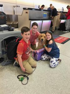 Family Flying with their pet